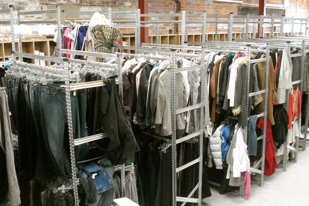 Image of clothing on rails, mixed jeans and a variety of garments