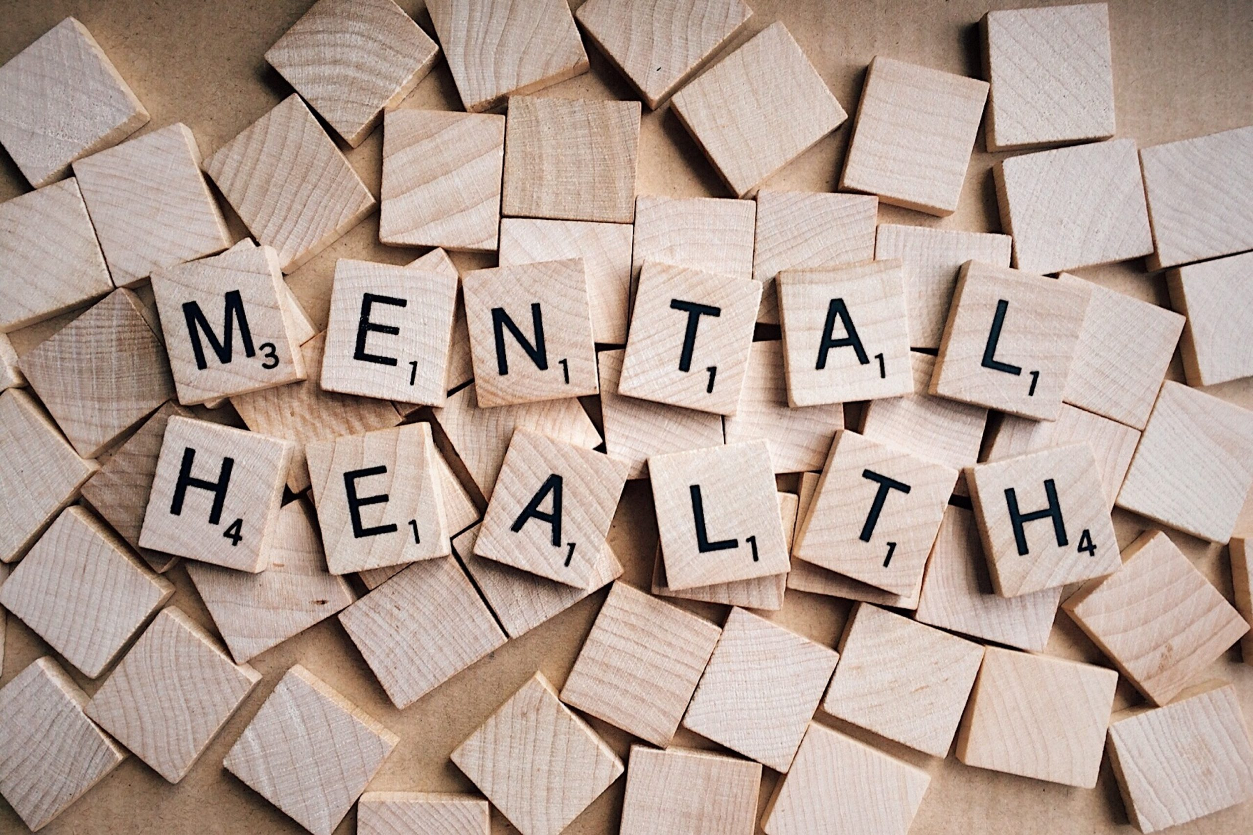Scrabble pieces with the words mental health spelt out