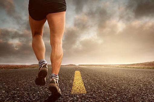 Runner running on open road